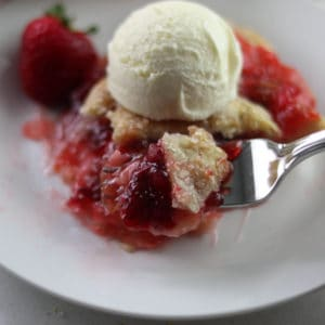 piece of strawberry rhubarb pie with ice cream