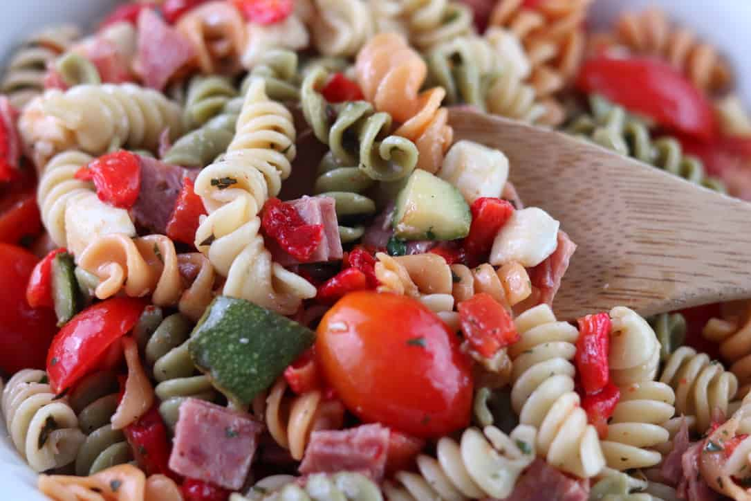 Tricolor Pasta Salad with Grilled Zucchini and Roasted Red Peppers.