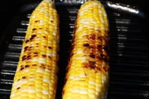 grilled corn on grill pan