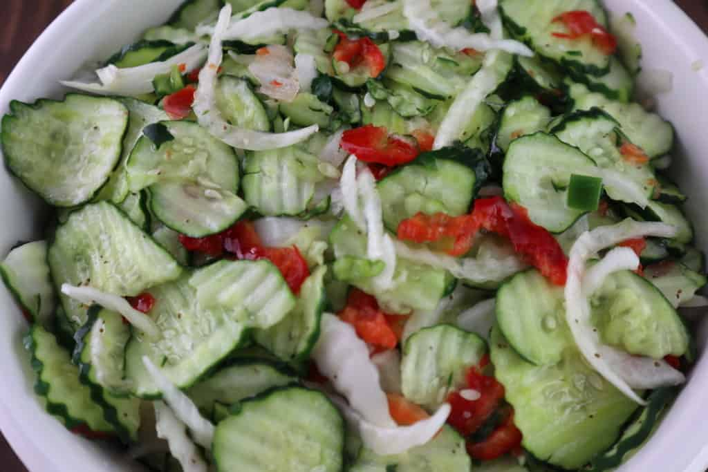 sweet cucumber pickles in bowl