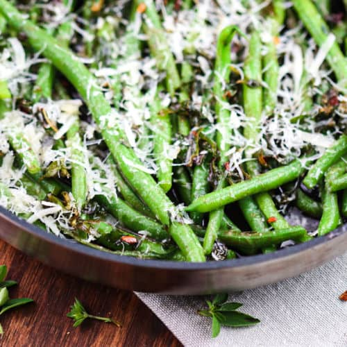 green beans with cheese in a skillet