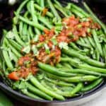 green beans and salsa in skillet
