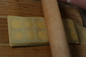 Seal top and bottom sheets with rolling pin