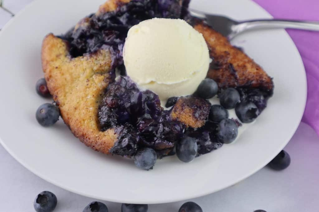 serving of bluebery cobbler with ice cream