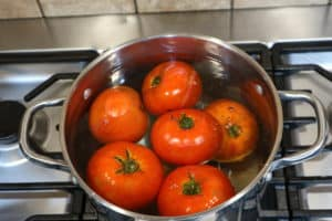 Blanching tomatoes in hot water