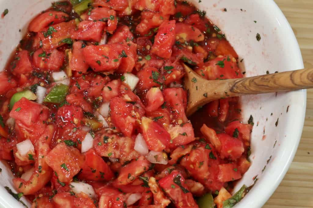 Tomatoes with herbs for canning