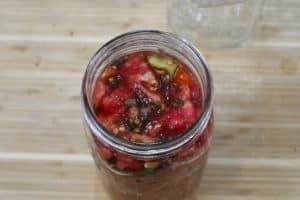 Italian style tomatoes in a canning jar