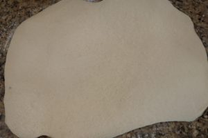 cinnamon rolls dough rolled out