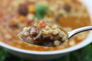 Spoon of beef barley soup