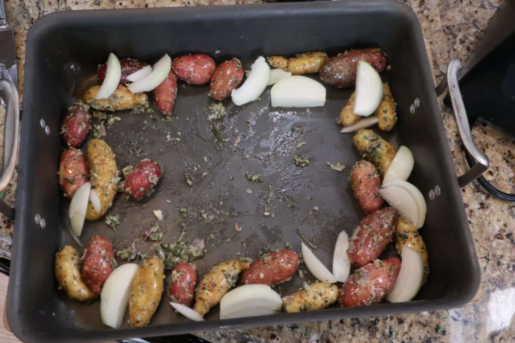 potatoes and onions in roasting pa