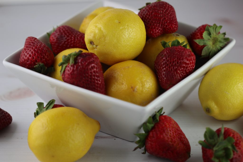lemons and strawberries in a bowl