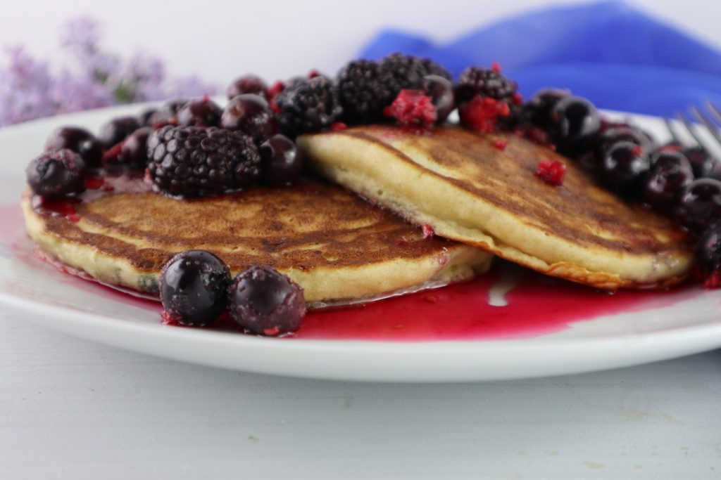 pancakes and berries on a plate