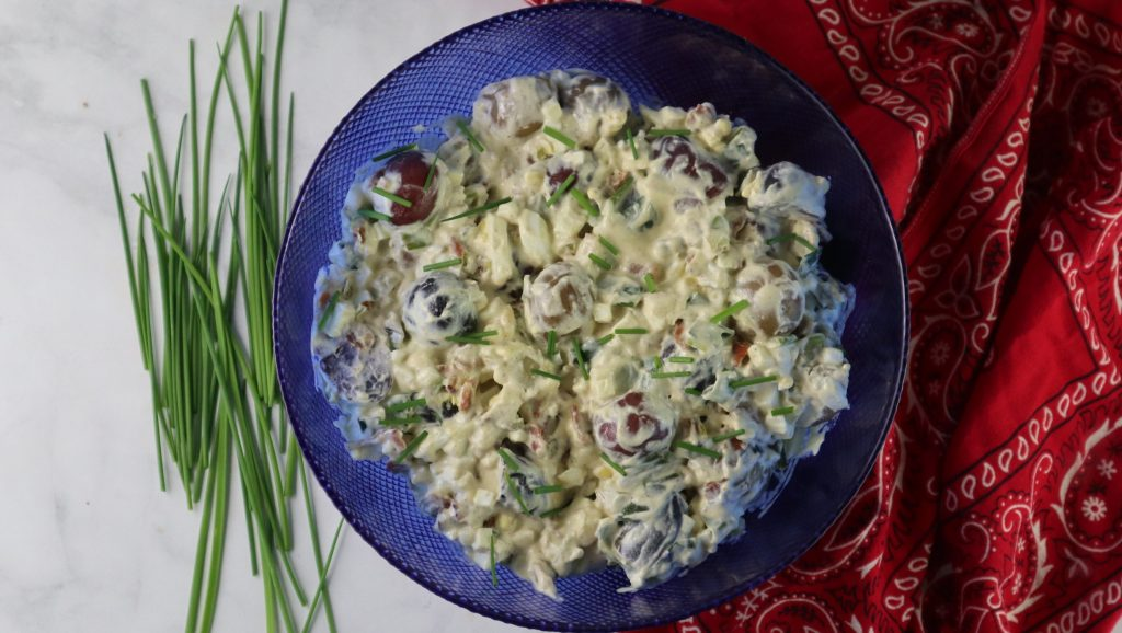 potato salad red white and blue in a bowl