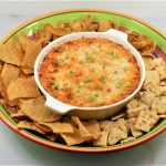 Buffalo Chicken Dip in a bowl with chips